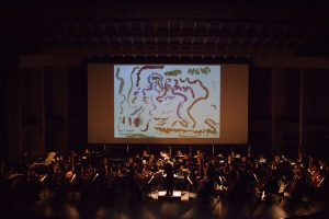 JSO concert featuring student artwork